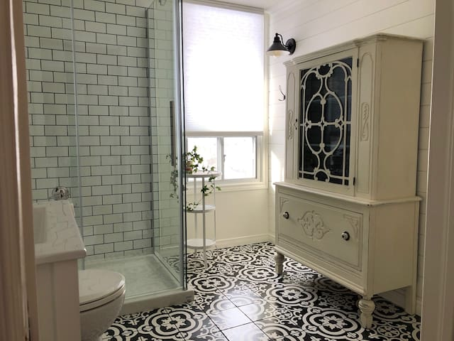 Relax in our newly renovated bathroom with a heated floor, glass shower and a cabinet full of plush towels