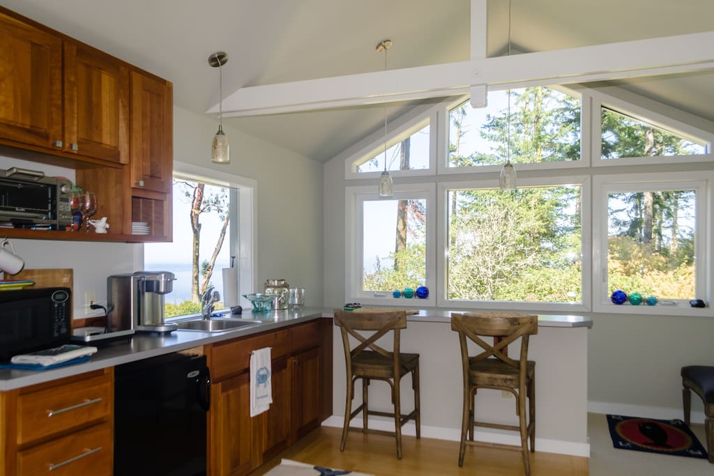 Upstairs: cooking and eating -- both with great westerly ocean  views!
