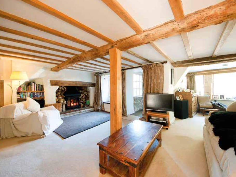 Original beams in the sitting room with Inglenook fireplace