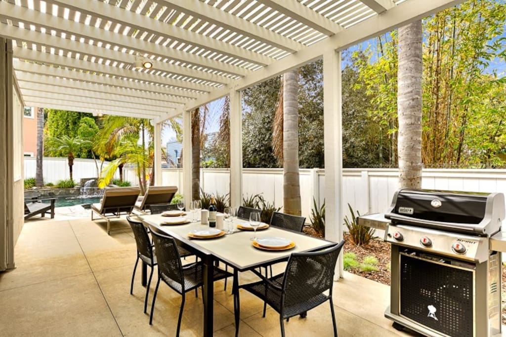 Enjoy outdoor dining & BBQ under the covered backyard patio.