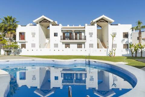 Luxury apartment, surrounded by several golf courses and near the sea
