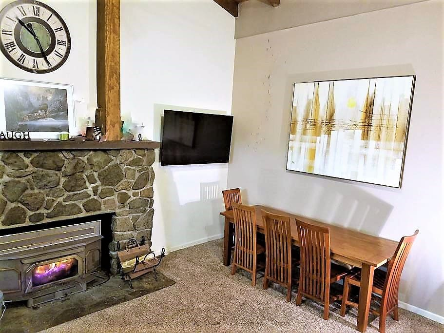 Huge stone fireplace is the centerpiece of the living room