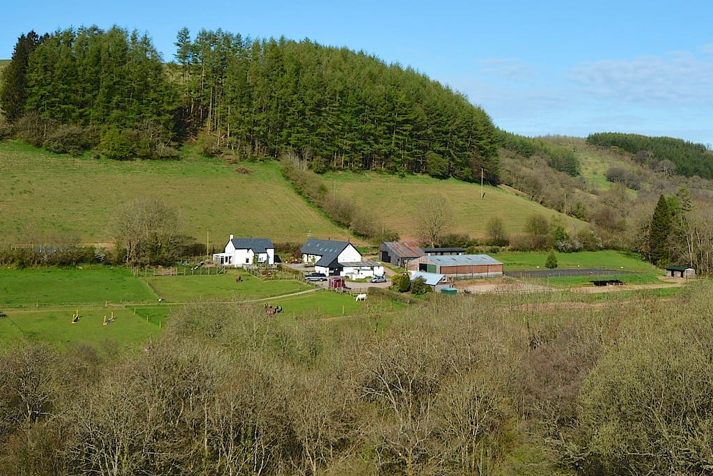 Gilfach farm, the cabin is just visible behind the barns.