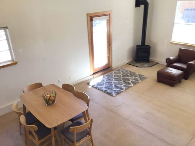Enter into large living room, dining room, kitchen, with gas fireplace.