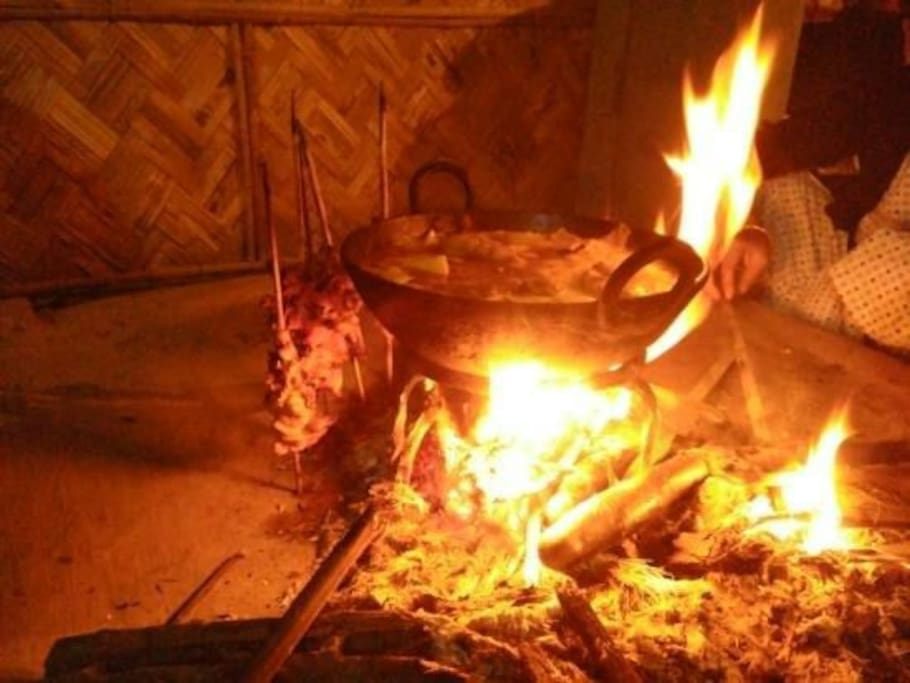 Preparing food in open fire