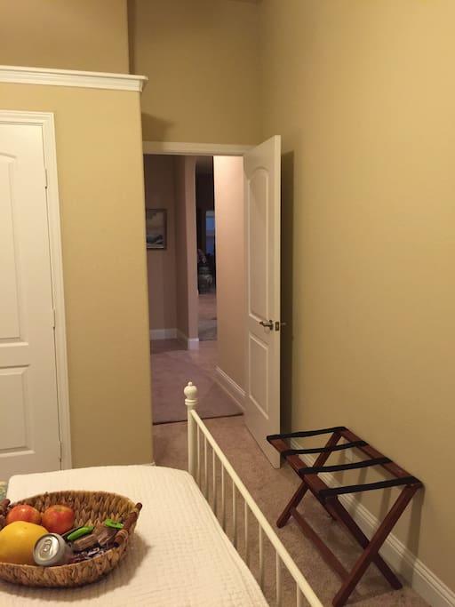 Hallway to private bathroom