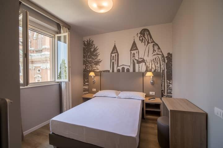 Camera Singola con letto alla Francese