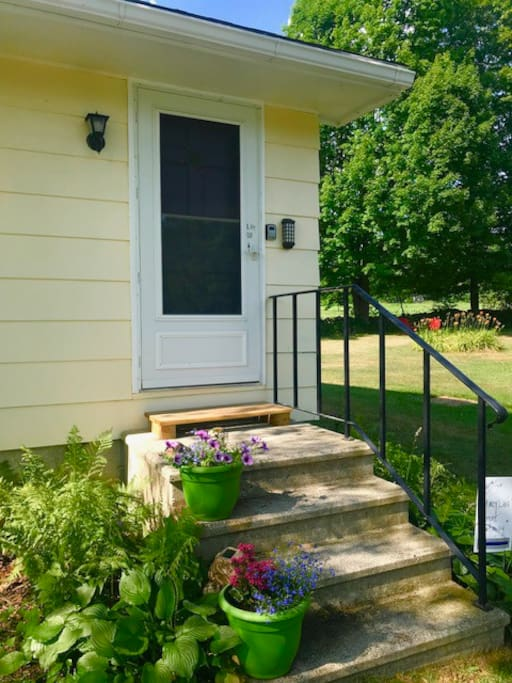 Private entrance with ample parking right outside your door. Sturdy hand rails and cement steps.