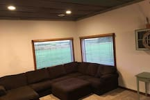 Couch for extra sleeping. The window to the east will feature the pond and sunrise with the grain elevator silhouette.