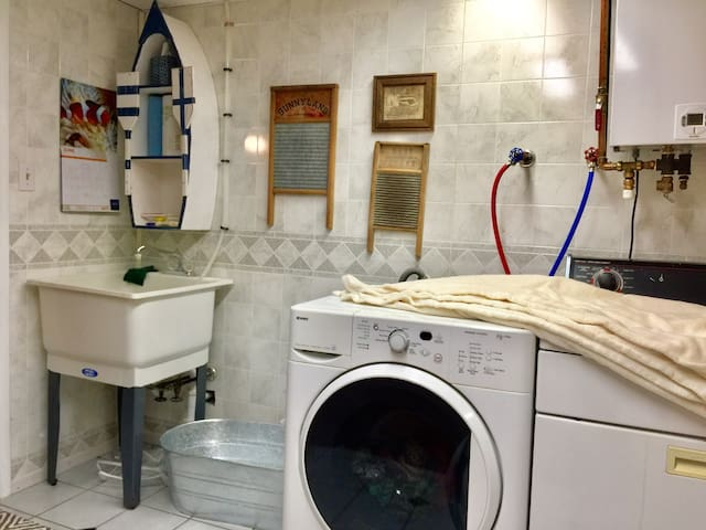 Bathroom with washer/dryer.