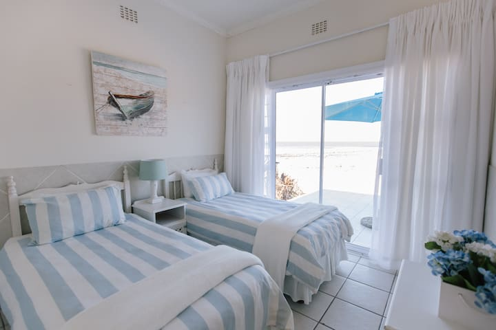 The second bedroom with full beach and river view.