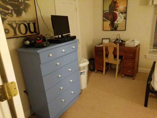 The room is a very simple room with a single/twin bed, a recliner, a desk and a dresser. It also does have a TV with Amazon Fire stick. You have Netflix, Prime, and Hulu. Kick back on the recliner and then you can binge out on your favorite TV show.