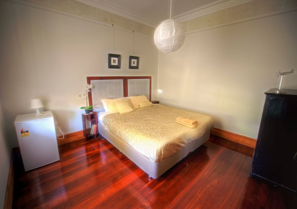 Large character room. Bed can be separated or joined to form a King Size bed. Bar fridge.