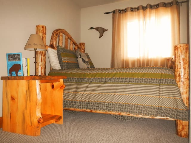 Third Bedroom.  Hand crafted full size log bed with full closet.