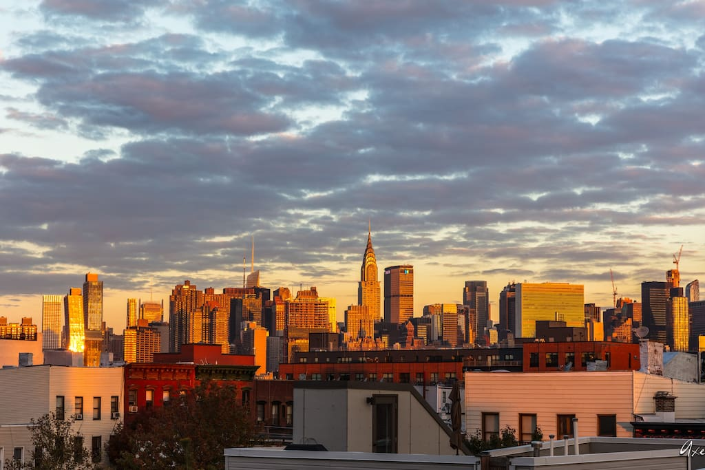 The view: The Manhattan Skyline. This is actually a photo from a guest! He woke up early just to catch the sunrise on the terrace. Sunsets and Sunrises are truly gorgeous here. The city looks closer in real life :)