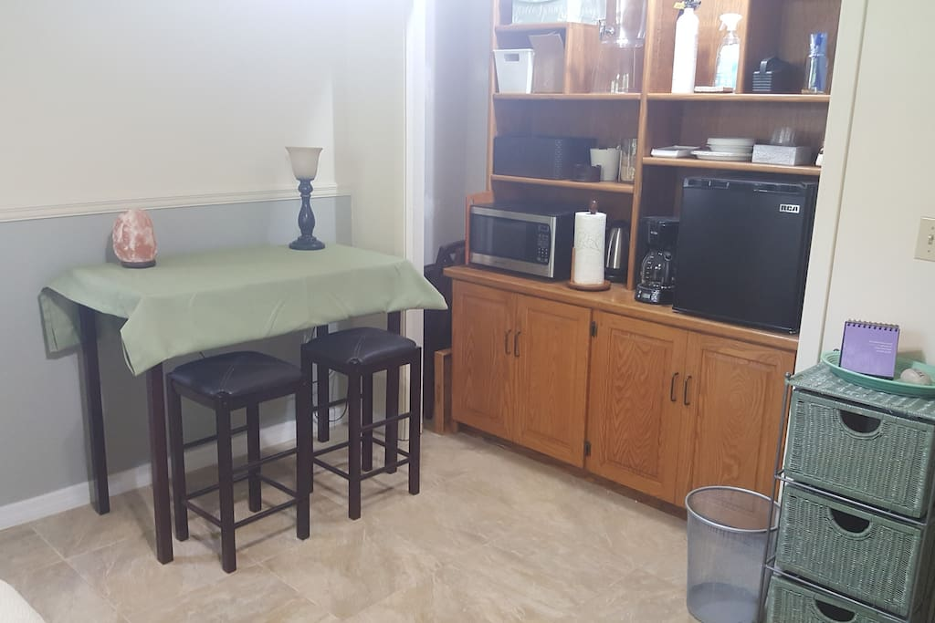 Part of sitting room- mini-kitchen (microwave, coffee maker, frig, basic kitchen supplies),  table & stools, fire extinguisher