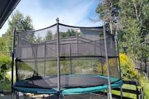 Big trampoline backside of house