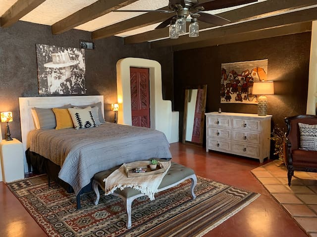 Relax and kick off your boots in the spacious Sundance room! You will sleep well in the ultra comfy queen size bed that looks out to the pool from the french windows/door.