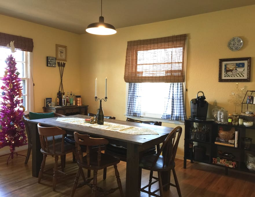 Dining area with coffee & tea station. Our rustic farm table seats up to 8.