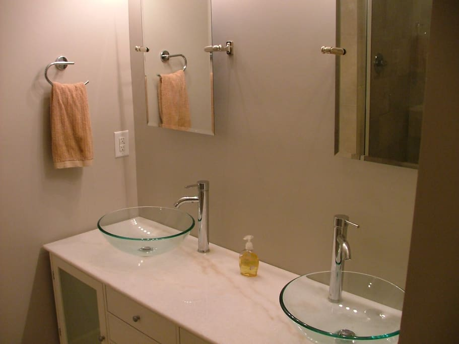 Hugh bathrooms with double sinks and massive 30sf showers with bench seating