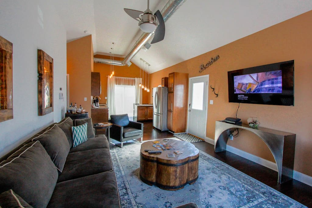 """Open floor plan. All new kitchen with Samsung appliances. 60"""" LG smartTV. Cozy living area with doorway to the Sunset Deck."""