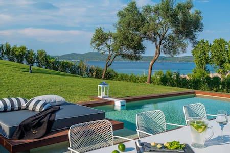 Villa on the beach with pool - Nea Roda
