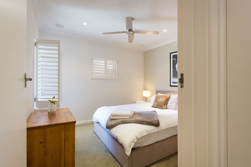 Bright and airy main bedroom