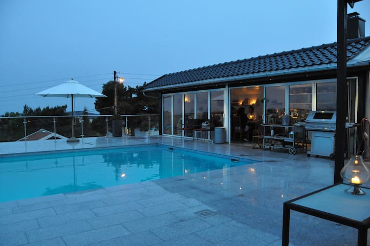 Pool Pavilion with folding doors, kitchen, wood baking oven. WC and outdoor shower
