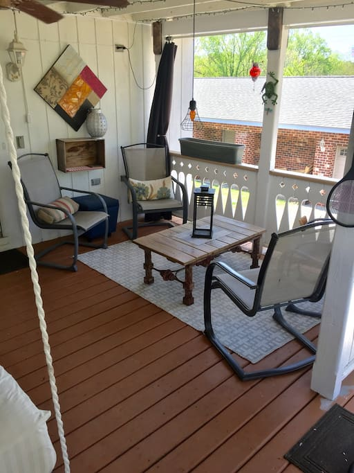 Porch has additional seating.