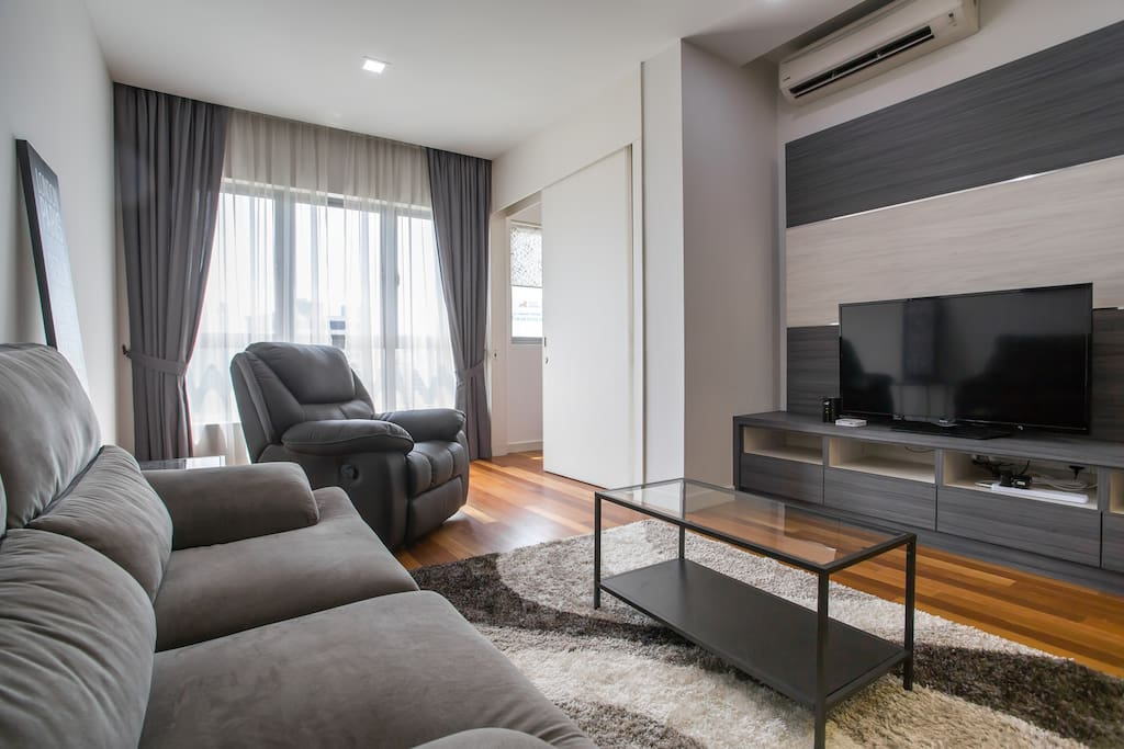 "Living Room - equipped with all the necessary amenities for your to enjoy such like 48"" LED TV, IPTV, air conditioning, WiFi, recliner chair and a comfortable sofa."