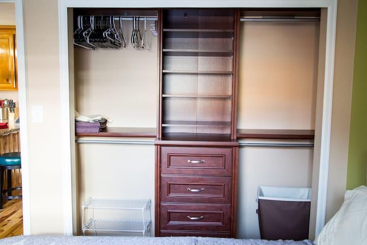 large custom closet in bedroom has plenty of storage