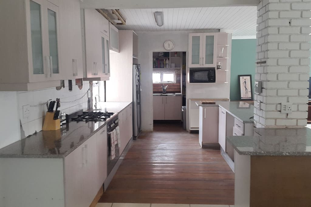 kitchen area with gas stove, scullery and laudry area