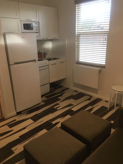 Kitchenette with microwave, sink, refrigerator, range