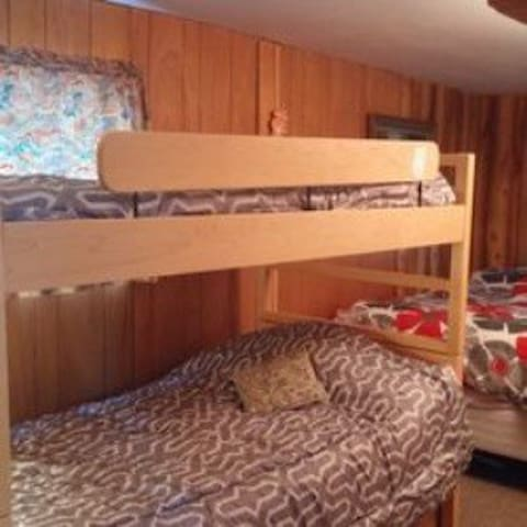 1st bedroom with single bunk beds and double bed