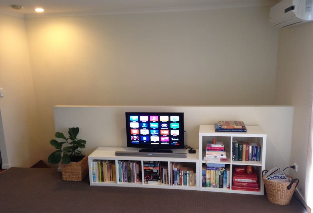 Living room- TV, Apple TV, Soundbar for music ( can Bluetooth to your smart phone) and plenty of books!