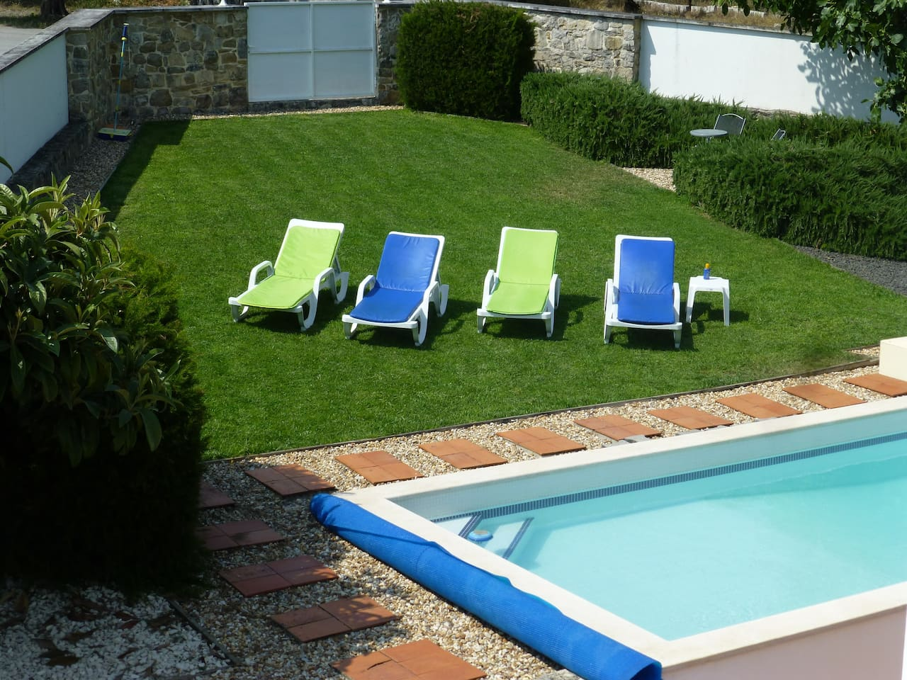 View of the private garden and pool from the roof terrace
