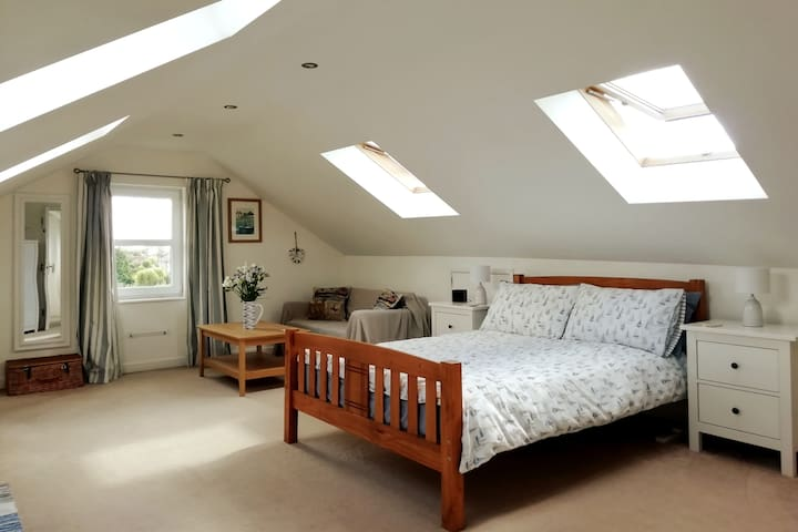 Spacious Loft Bedroom with Private Bathroom