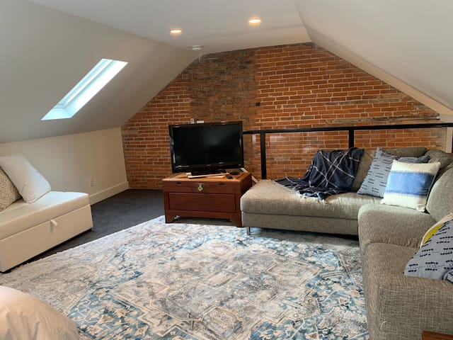 stairs into loft and bedroom area.