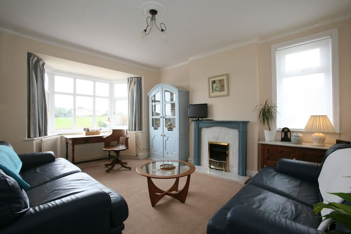 Guest Sitting Room with TV, radio, board games , cards, maps. Desk space.