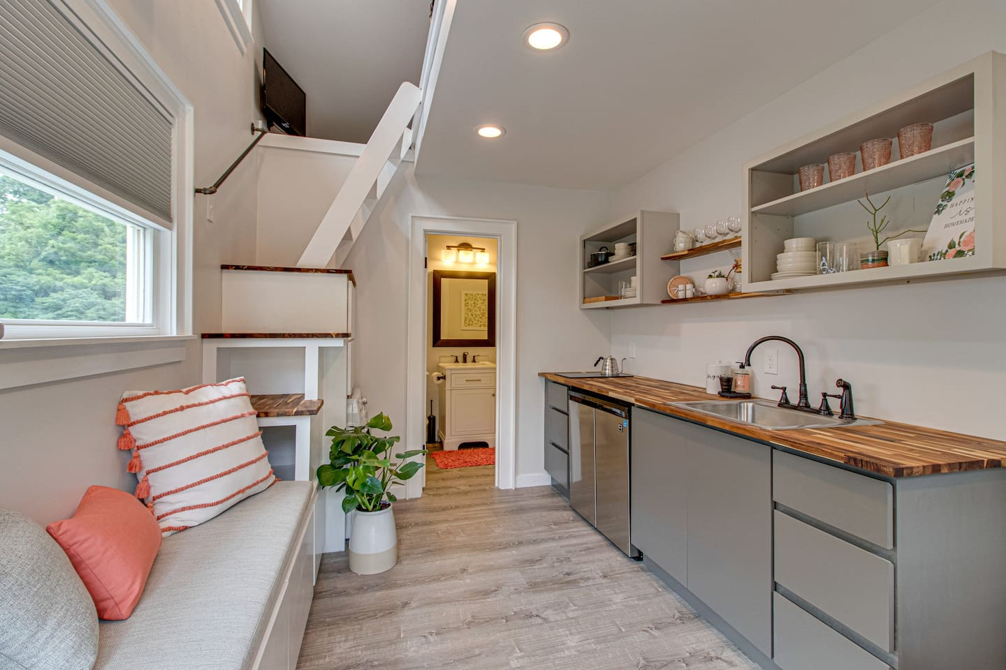 Our 165 square foot tiny house is small but amazing accommodating. We have everything you need to stay cozy designed into the space including fridge/freezer, washer/dryer, dishes, stovetop, toaster oven, tv, toiletries and more.