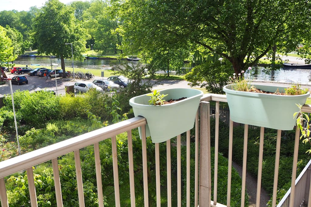 Balcony with view of canal and large shared garden