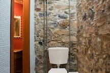 Toilet with the characteristic stone wall!