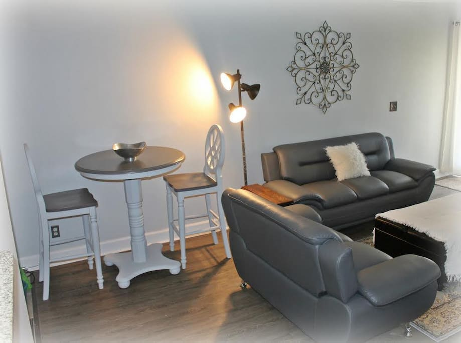 Living/Dining area with new leather couch and loveseat