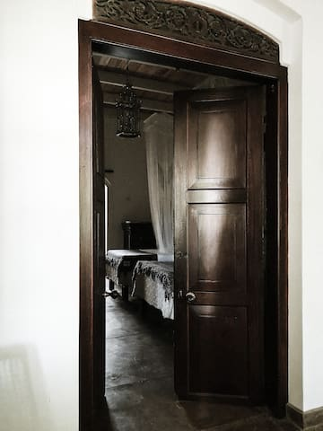 Entrance to the twin room, antique doors