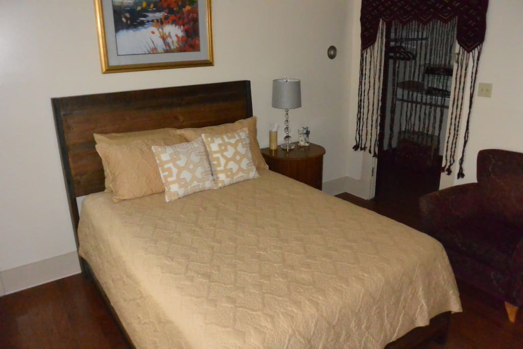 Queen-sized bed in private room.