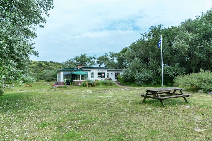 Holiday home in the dunes of Burgh-Haamstede with a view of the lighthouse