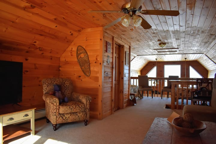 Spacious loft to spread out in. This area is great for the kiddos to play in but still within proximity to parents. There is a half bath in the loft.