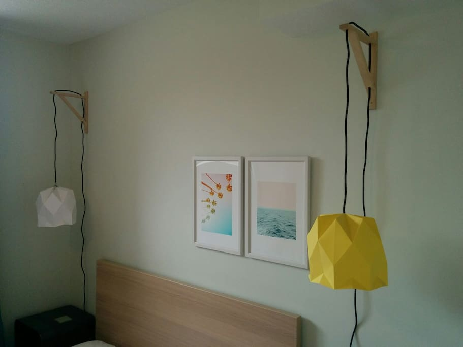 Bedside lighting and artwork in bedroom