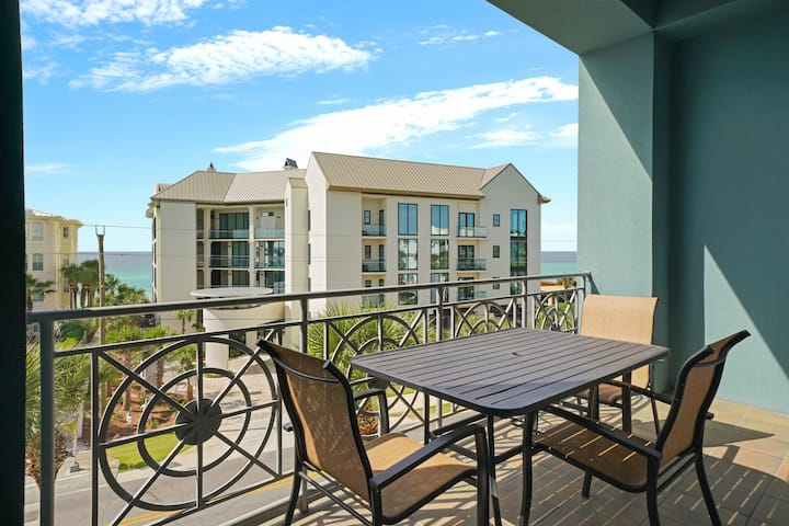 Spacious condo w/ large living area, private balcony & shared pool!