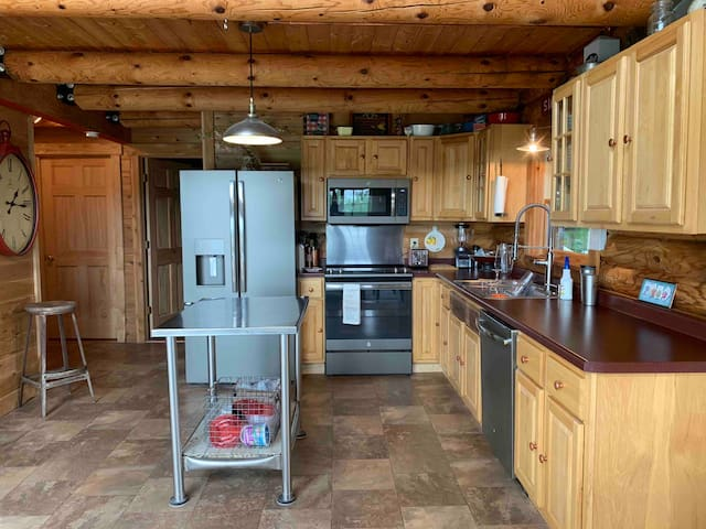 Kitchen has new appliances along with coffee grinder, coffee maker, blender, mixer, waffle maker, electric skillet, large crockpot, electric tea kettle, many pots and pans and dishes. Tea,coffee, oils, spices, limited paper products, and dish soap.